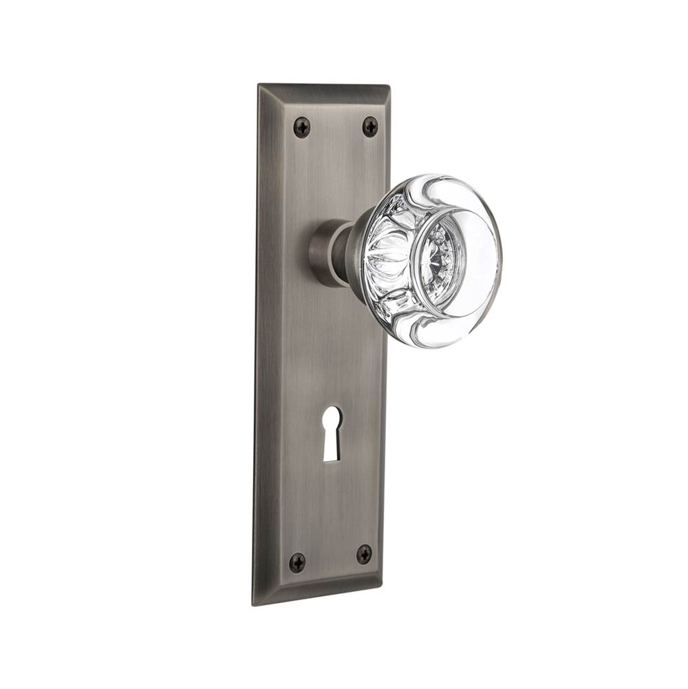 Nostalgic Warehouse   712564   New York Plate With Keyhole Privacy Round  Clear Crystal Glass Door Knob In Antique Pewter